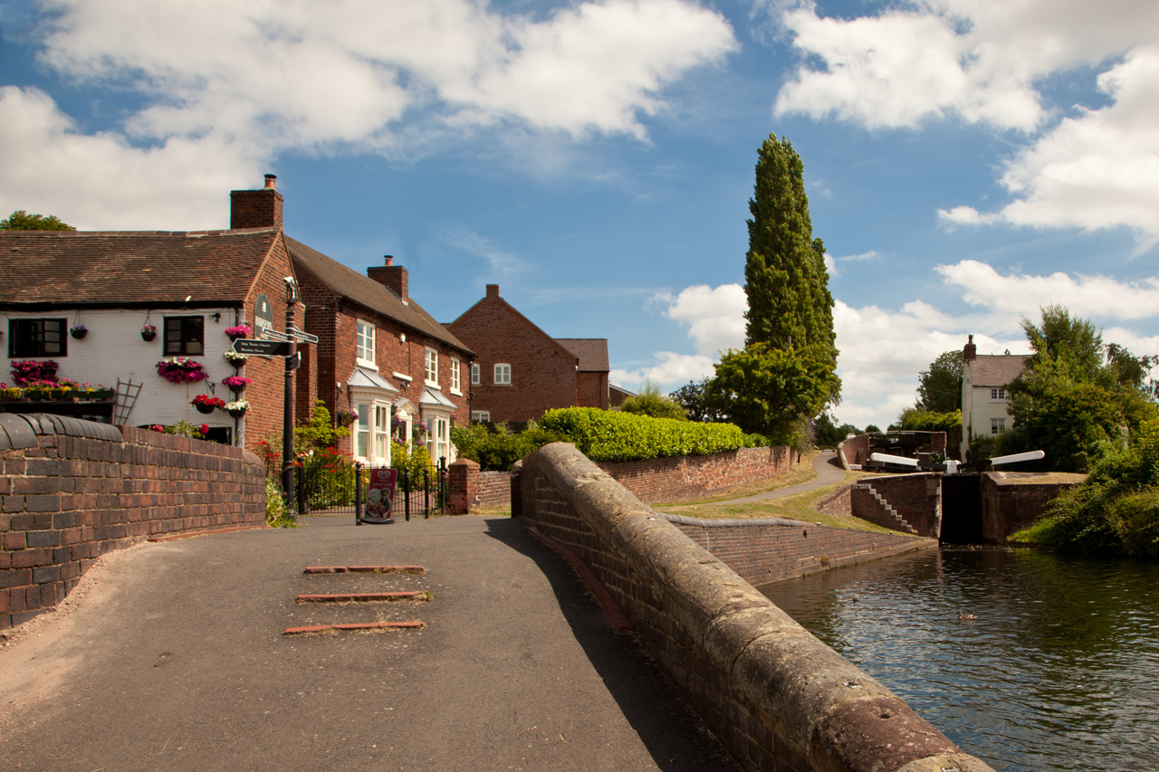 Stourbridge Canal on BCN, looking NE to Lock 10. Photo taken on 9 July 2010. The Dock off licence and general store is on the left. The immediate area is a super place to spend half a day. There are lovely lawns before this shot and the Redhouse Glass Centre where within an original conicular building you can see glass objects being blown and drawn and can purchase all sorts of attractive objects. There's a super low priced tea room as well