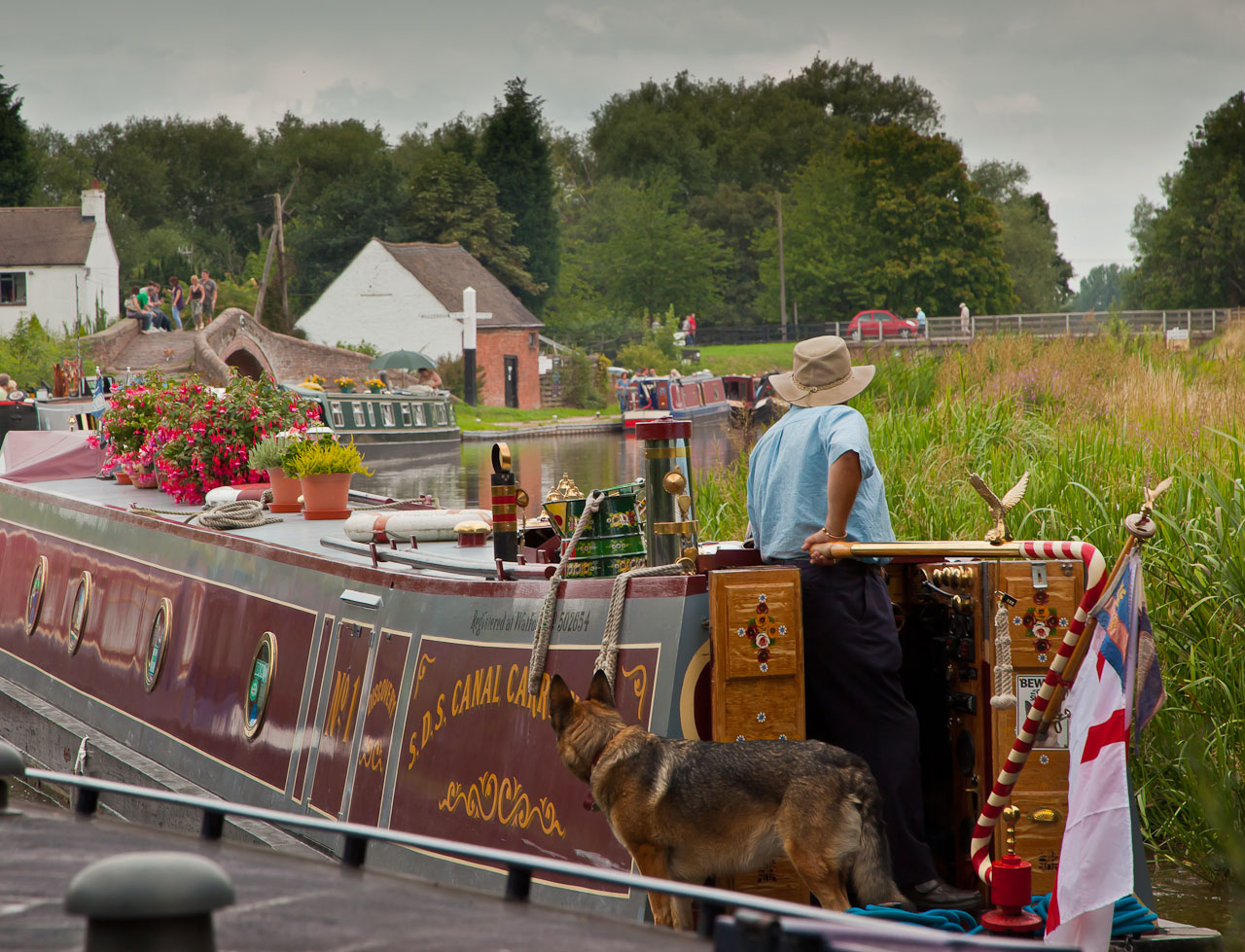 Great Haywood Junction, of the Trent and Mersey with the Staffs and Worcester canals 4 miles East of Stafford. (The Staffs and Worcester bears off to the left from the bridge on the extreme left). This is a very popular place for those cruising to moor for the night and also for visitors to Shugborough Hall which is just across a canal bridge from Great Haywood Village. There is a delightful coffee shop/cafe by the bridge which overlooks the canal.