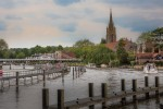 View west from Marlow Lock with All Saints Church and Marlow Bridge in the distance.