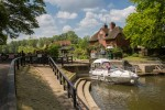 Leaving Sonning Lock watched over by the Lock keeper.