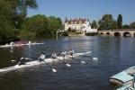 Schoolgirls' regatta at Maidenhead with Maidenhead Bridge and the Riviera Hotel beyond.