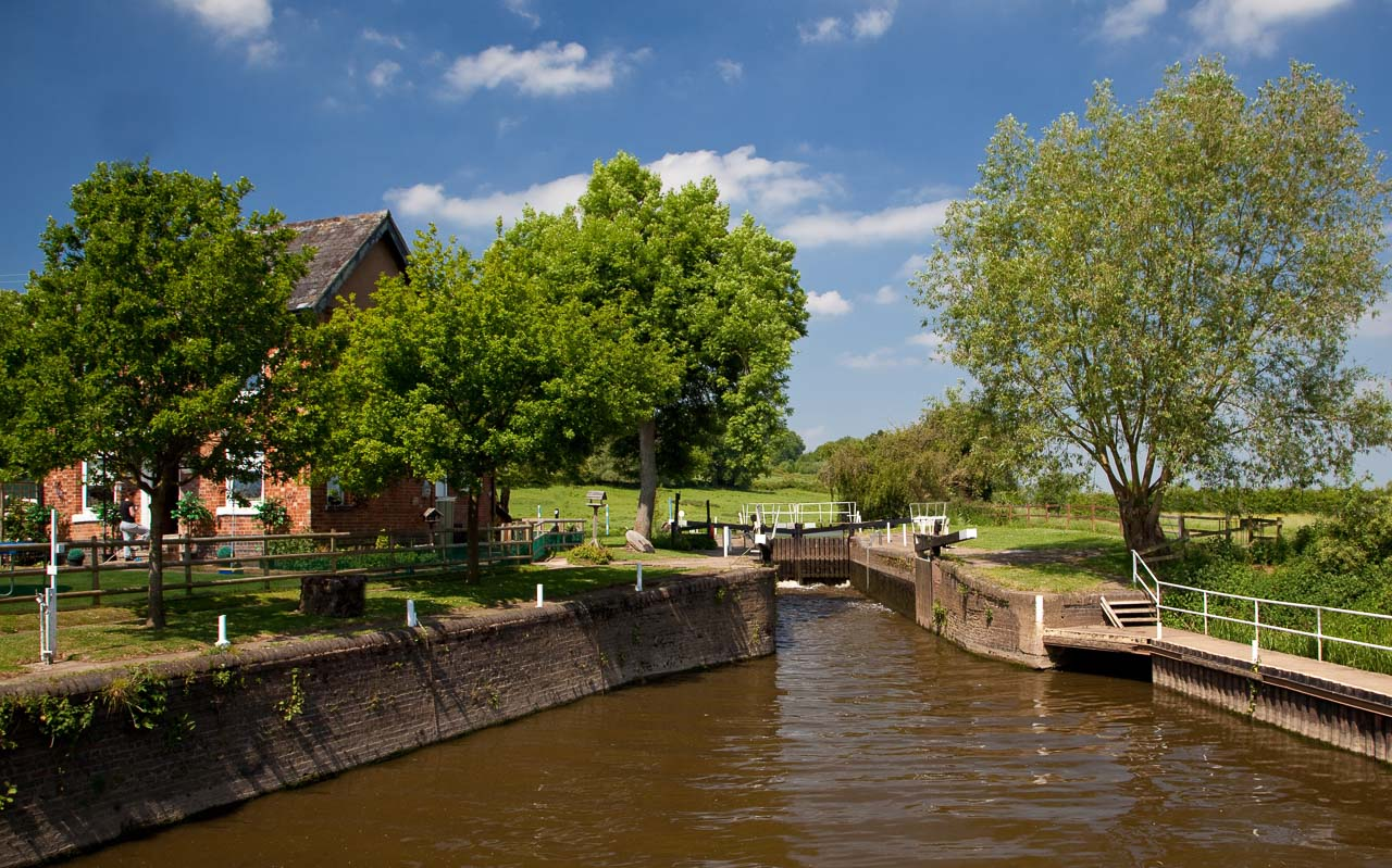 River Avon - Strensham Lock off Jn 8 of the M5. The house is situated on an island between the Avon river weir and the lock bypass waterway.